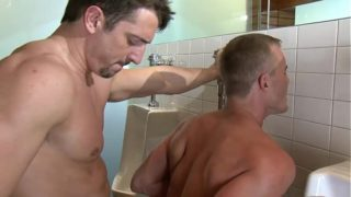 Two gays fuck each other's asses in a disco bathroom