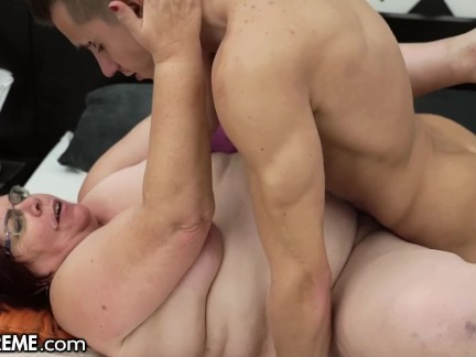A young man fucks a very vicious old fat lady